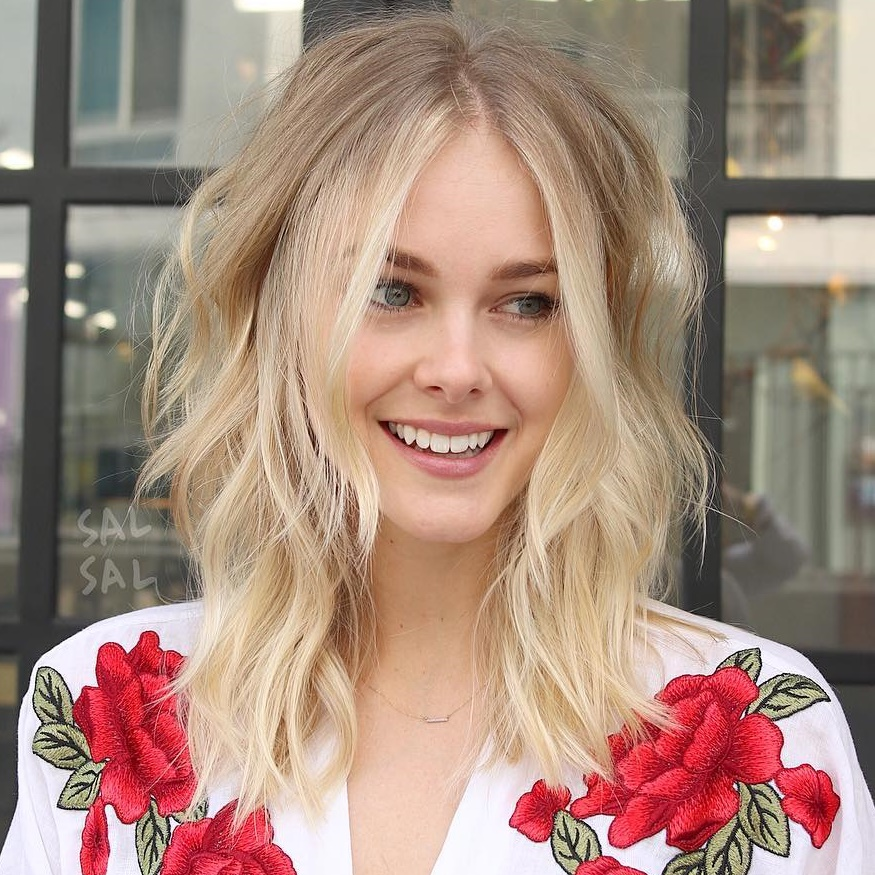 Medium Layered Blonde Hairstyle With Centre Parting
