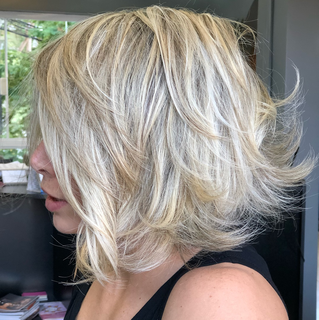 White Blonde Feathered Lob Hairstyle