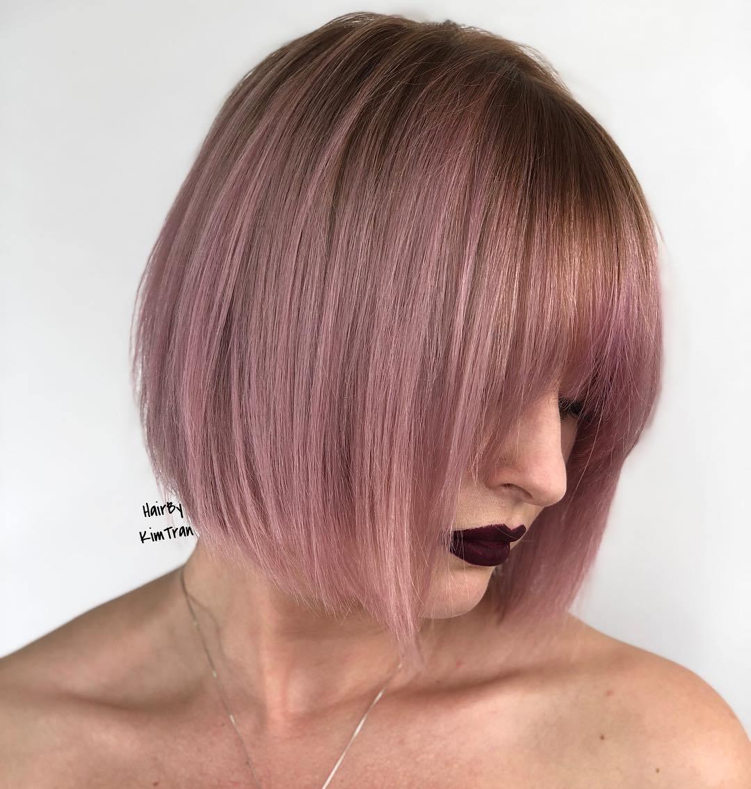 Sleek Pastel Pink Bob With Bangs