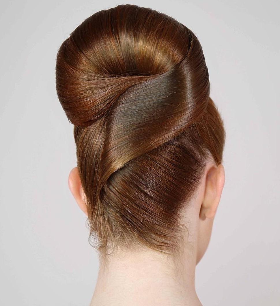 Sleek Roll Updo For Straight Hair